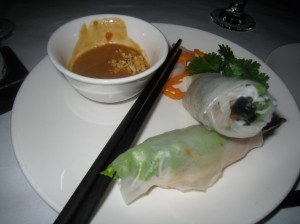 Grilled prawns wrapped in rice paper with cucumber, basil & peanut sauce