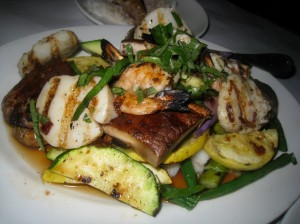 Grilled shrimp and scallops with vegetables in a lime basil sauce