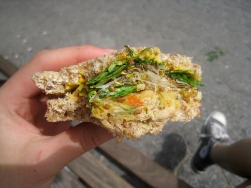 Hummus, sprout, veggie burger & arugula sandwich